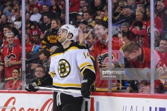 CALGARY, AB - DECEMBER 4: Calgary Flames fans try to get the attention of Brett Connolly #14 of the Boston Bruins during a break in play at the Scotiabank Saddledome on December 4, 2015 in Calgary, Alberta, Canada. (Photo by Derek Leung/Getty Images)