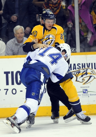 Feb 10, 2015; Nashville, TN, USA; Nashville Predators defenseman Anthony Bitetto (83) exchanges punches with Tampa Bay Lightning right winger Brett Connolly (14) during the second period at Bridgestone Arena. Mandatory Credit: Christopher Hanewinckel-USA TODAY Sports