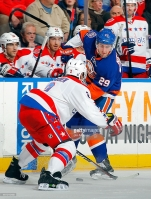 in action against the on December 29, 2014 at Nassau Veterans Memorial Coliseum in Uniondale, New York. The Islanders defeat the Capitals 4-3 in overtime.