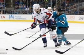 SAN JOSE, CA - MARCH 10: Eric Fehr #16 of the San Jose Sharks competes for the puck against Brett Connolly #10 of the Washington Capitals during the third period at SAP Center on March 10, 2018 in San Jose, California. (Photo by Lachlan Cunningham/Getty Images)