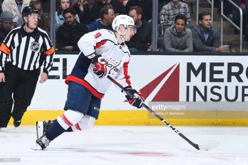 LOS ANGELES, CA - MARCH 8: Dmitry Orlov #9 of the Washington Capitals handles the puck during a game against the Los Angeles Kings at STAPLES Center on March 8, 2018 in Los Angeles, California. (Photo by Andrew D. Bernstein/NHLI via Getty Images) *** Local Caption ***
