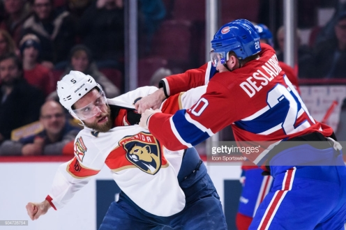 MONTREAL, QC - MARCH 19: Montreal Canadiens left wing Nicolas Deslauriers (20) and Florida Panthers defenseman Aaron Ekblad (5) fight during the first period of the NHL game between the Florida Panthers and the Montreal Canadiens on March 19, 2018, at the Bell Centre in Montreal, QC (Photo by Vincent Ethier/Icon Sportswire via Getty Images)