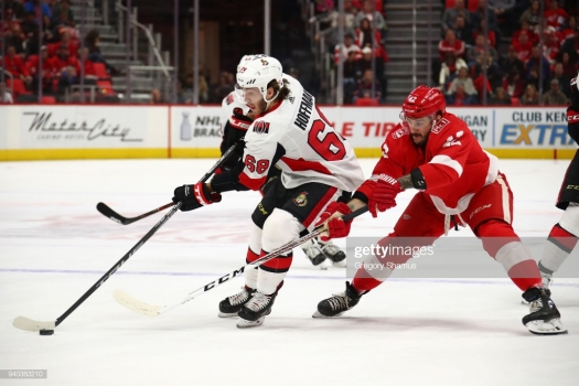 DETROIT, MI - MARCH 31: Mike Hoffman #68 of the Ottawa Senators tries to get around the stick of Martin Frk #42 of the Detroit Red Wings during the first period at Little Caesars Arena on March 31, 2018 in Detroit, Michigan. (Photo by Gregory Shamus/Getty Images)