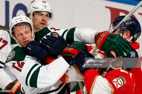 SUNRISE, FL - DECEMBER 22: Vincent Trocheck #21 of the Florida Panthers tangles with Eric Staal #12 of the Minnesota Wild at the BB&T Center on December 22, 2017 in Sunrise, Florida. (Photo by Eliot J. Schechter/NHLI via Getty Images)