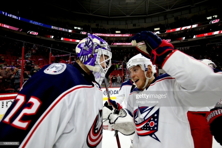 RALEIGH, NC - NOVEMBER 17: Cam Atkinson #13 of the Columbus Blue Jackets congratulates goaltender Sergei Bobrovsky #72 on his win against the Carolina Hurricanes during an NHL game on November 17, 2018 at PNC Arena in Raleigh, North Carolina. (Photo by Gregg Forwerck/NHLI via Getty Images)