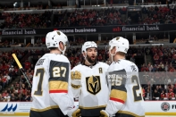 CHICAGO, IL - JANUARY 12: Deryk Engelland #5 of the Vegas Golden Knights talks with teammates Shea Theodore #27 and Paul Stastny #26 in the first period against the Chicago Blackhawks at the United Center on January 12, 2019 in Chicago, Illinois. (Photo by Bill Smith/NHLI via Getty Images)