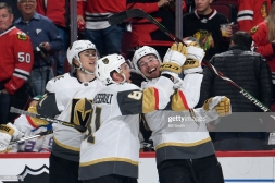 CHICAGO, IL - JANUARY 12: William Karlsson #71 and Jonathan Marchessault #81 celebrate with Shea Theodore #27 of the Vegas Golden Knights after Theodore scored in overtime against the Chicago Blackhawks at the United Center on January 12, 2019 in Chicago, Illinois. (Photo by Bill Smith/NHLI via Getty Images)