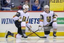 WINNIPEG, MB - JANUARY 15: Shea Theodore #27 and Paul Stastny #26 of the Vegas Golden Knights chat during the pre-game warm up prior to NHL action against the Winnipeg Jets at the Bell MTS Place on January 15, 2019 in Winnipeg, Manitoba, Canada. (Photo by Darcy Finley/NHLI via Getty Images)