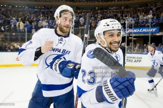 NEW YORK, NY - MAY 29: Victor Hedman #77 and J.T. Brown #23 of the Tampa Bay Lightning celebrate their victory over the New York Rangers in Game Seven of the Eastern Conference Final during the 2015 NHL Stanley Cup Playoffs at Madison Square Garden on May 29, 2015 in New York, New York. The Tampa Bay Lightning defeated the New York Rangers 2-0 (Photo by Scott Audette/NHLI via Getty Images)
