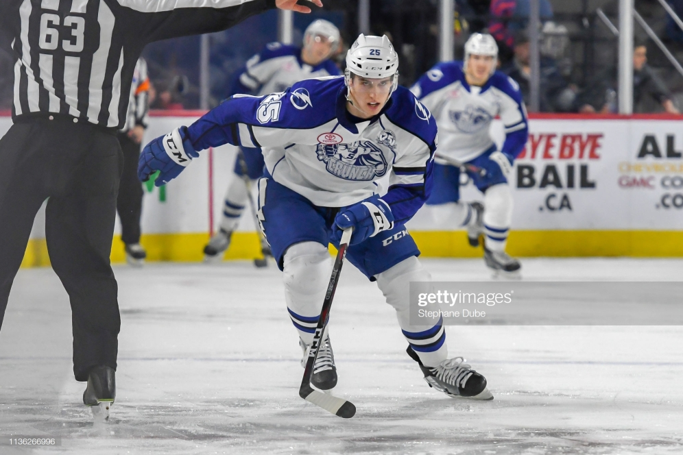 LAVAL, QC, CANADA - MARCH 13: Cal Foote #25 of the Syracuse Crunch skates up the ice during a match against the Laval Rocket at Place Bell on March 13, 2019 in Laval, Quebec. (Photo by Stephane Dube/Getty Images)