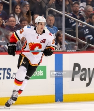 WINNIPEG, MB - DECEMBER 27: Sean Monahan #23 of the Calgary Flames keeps an eye on the play during second period action against the Winnipeg Jets at the Bell MTS Place on December 27, 2018 in Winnipeg, Manitoba, Canada. The Flames defeated the Jets 4-1. (Photo by Jonathan Kozub/NHLI via Getty Images)