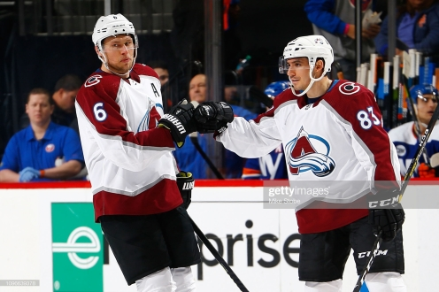 NEW YORK, NY - FEBRUARY 09: Erik Johnson #6 of the Colorado Avalanche celebrates his second period goal against the New York Islanders with Matt Nieto #83 at Barclays Center on February 9, 2019 the Brooklyn borough of New York City. (Photo by Mike Stobe/NHLI via Getty Images)