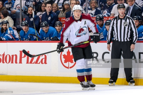 WINNIPEG, MB - FEBRUARY 14: Erik Johnson #6 of the Colorado Avalanche keeps an eye on the play during first period action against the Winnipeg Jets at the Bell MTS Place on February 14, 2019 in Winnipeg, Manitoba, Canada. The Avs defeated the Jets 4-1. (Photo by Jonathan Kozub/NHLI via Getty Images)