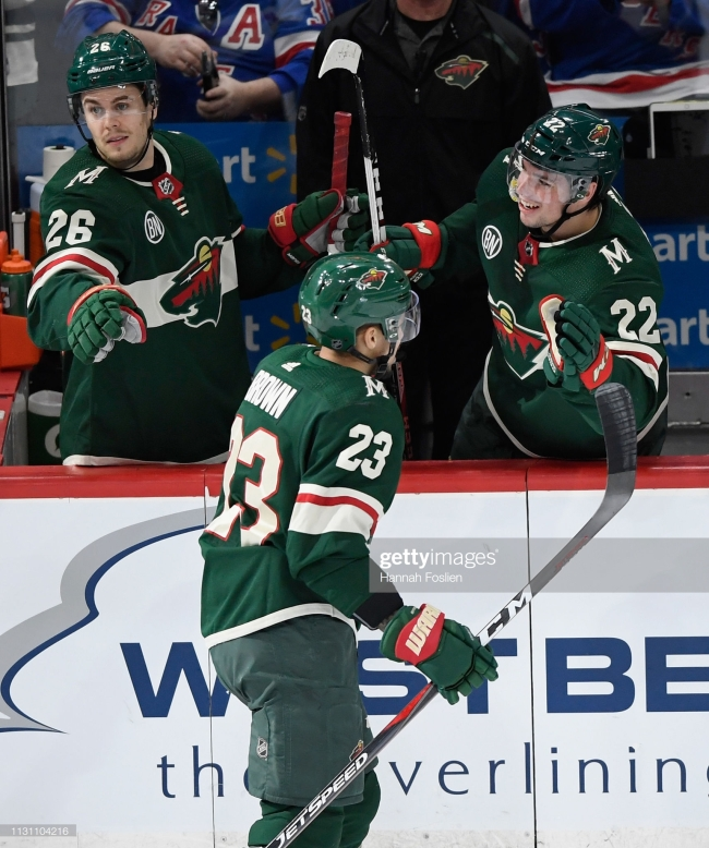 ST PAUL, MN - MARCH 16: Pontus Aberg #26 and Kevin Fiala #22 of the Minnesota Wild congratulate teammate J.T. Brown #23 on scoring an empty net goal against the New York Rangers during the third period of the game on March 16, 2019 at Xcel Energy Center in St Paul, Minnesota. The Wild defeated the Rangers 5-2. (Photo by Hannah Foslien/Getty Images)