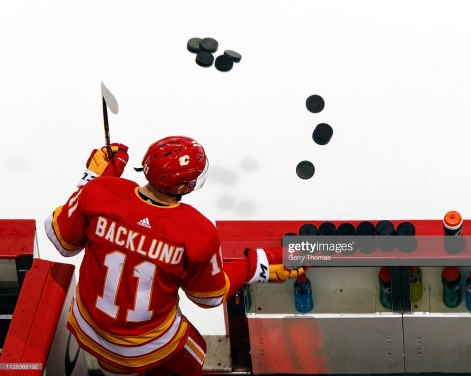 CALGARY, AB - FEBRUARY 20: Mikael Backlund #11 of the Calgary Flames steps onto the ice for warmups before an NHL game against the New York Islanders on February 20, 2019 at the Scotiabank Saddledome in Calgary, Alberta, Canada. (Photo by Gerry Thomas/NHLI via Getty Images)