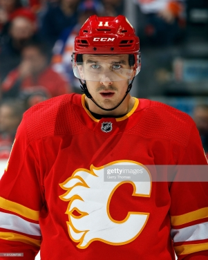CALGARY, AB - FEBRUARY 20: Mikael Backlund #11 of the Calgary Flames looks on against the New York Islanders during an NHL game on February 20, 2019 at the Scotiabank Saddledome in Calgary, Alberta, Canada. (Photo by Gerry Thomas/NHLI via Getty Images)