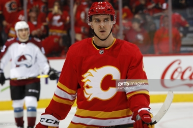 """CALGARY, AB - APRIL 11: Mikael Backlund #11 of the Calgary Flames skates against the Colorado Avalanche in Game One of the Western Conference First Round during the 2019 NHL Stanley Cup Playoffs on April 11, 2019 at the Scotiabank Saddledome in Calgary, Alberta, Canada. (Photo by Gerry Thomas/NHLI via Getty Images)""""n"""