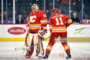 CALGARY, AB - MARCH 15: Calgary Flames Goalie David Rittich (33) and Center Mikael Backlund (11) warm up before an NHL game where the Calgary Flames hosted the New York Rangers on March 15, 2019, at the Scotiabank Saddledome in Calgary, AB. (Photo by Brett Holmes/Icon Sportswire via Getty Images)