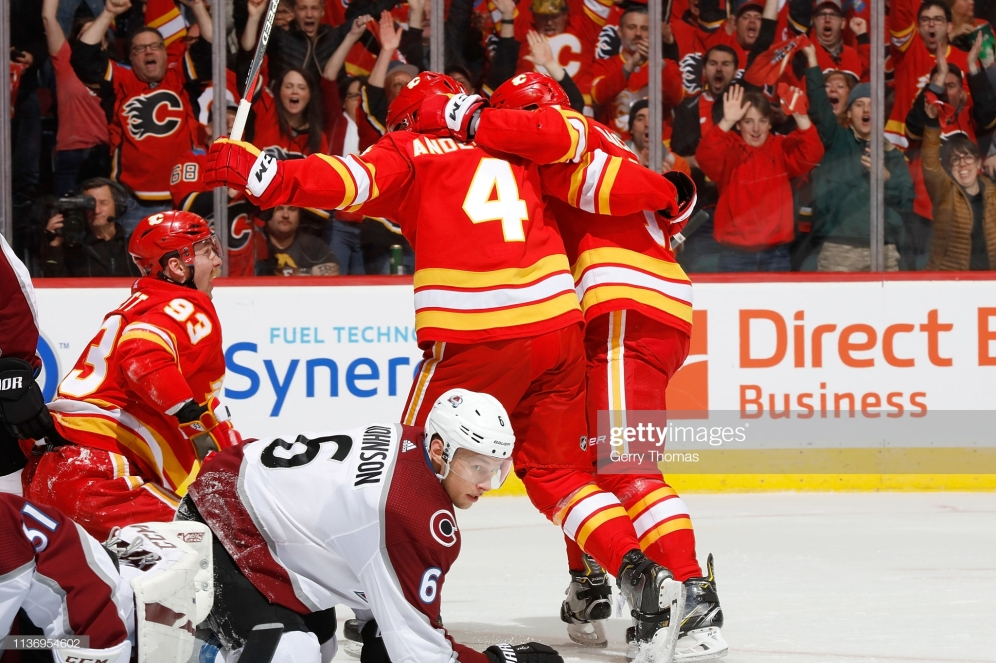 CALGARY, AB - APRIL 13: Rasmus Andersson #4, Sam Bennett #93 and teammates of the Calgary Flames celebrate a goal against the Colorado Avalanche in Game Two of the Western Conference First Round during the 2019 NHL Stanley Cup Playoffs on April 13, 2019 at the Scotiabank Saddledome in Calgary, Alberta, Canada. (Photo by Gerry Thomas/NHLI via Getty Images)