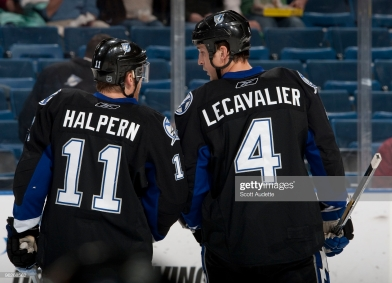 TAMPA, FL - JANUARY 29: Vincent Lecavalier #4 of the Tampa Bay Lightning talks with teammate Jeff Halpern #11 during a break in the action against the Anaheim Ducks at the St. Pete Times Forum on January 29, 2010 in Tampa, Florida. (Photo by Scott Audette/NHLI via Getty Images)