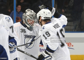 ATLANTA - JANUARY 20: Dominic Moore #19 and Dwayne Roloson #35 of the Tampa Bay Lightning celebrate after the game against the Atlanta Thrashers at Philips Arena on January 20, 2011 in Atlanta, Georgia. (Photo by Scott Cunningham/NHLI via Getty Images)