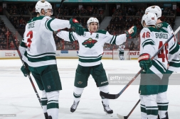 OTTAWA, ON - JANUARY 5: Jared Spurgeon #46 of the Minnesota Wild celebrates his second goal of a game against the Ottawa Senators with teammates including Charlie Coyle #3, Zach Parise #11 at Canadian Tire Centre on January 5, 2019 in Ottawa, Ontario, Canada. (Photo by Andre Ringuette/NHLI via Getty Images)