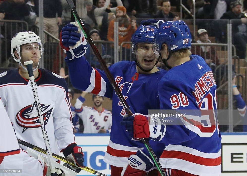 NEW YORK, NEW YORK - DECEMBER 27: Chris Kreider #20 of the New York Rangers (l) celebrates his power-play goal at 1:45 of the second period and is joined by Vladislav Namestnikov #90 (r) at Madison Square Garden on December 27, 2018 in New York City. (Photo by Bruce Bennett/Getty Images)