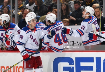 PITTSBURGH, PA - APRIL 06: Brady Skjei #76 of the New York Rangers celebrates his goal with teammates during the third period against the Pittsburgh Penguins at PPG Paints Arena on April 6, 2019 in Pittsburgh, Pennsylvania. (Photo by Joe Sargent/NHLI via Getty Images)