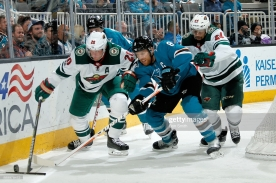 SAN JOSE, CA - DECEMBER 10: Ryan Suter #20 of the Minnesota Wild and Joe Pavelski #8 of the San Jose Sharks battle for the puck at SAP Center on December 10, 2017 in San Jose, California. (Photo by Don Smith/NHLI via Getty Images)