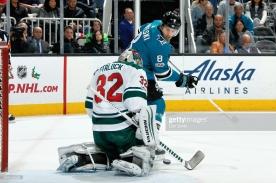 SAN JOSE, CA - DECEMBER 10: Alex Stalock #32 of the Minnesota Wild makes a save as Joe Pavelski #8 of the San Jose Sharks looks at SAP Center on December 10, 2017 in San Jose, California. (Photo by Don Smith/NHLI via Getty Images)
