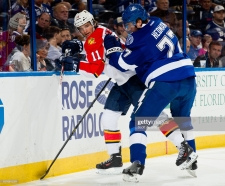 TAMPA, FL - APRIL 27: Victor Hedman #77 of the Tampa Bay Lightning checks Jonathan Huberdeau #11 of the Florida Panthers during the second period of the game at the Tampa Bay Times Forum on April 27, 2013 in Tampa, Florida. (Photo by Scott Audette/NHLI via Getty Images)