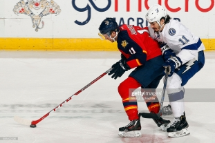 SUNRISE, FL - JANUARY 23: Jonathan Huberdeau #11 of the Florida Panthers skates with the puck against Brian Boyle #11 of the Tampa Bay Lightning at the BB&T Center on January 23, 2016 in Sunrise, Florida. (Photo by Eliot J. Schechter/NHLI via Getty Images)