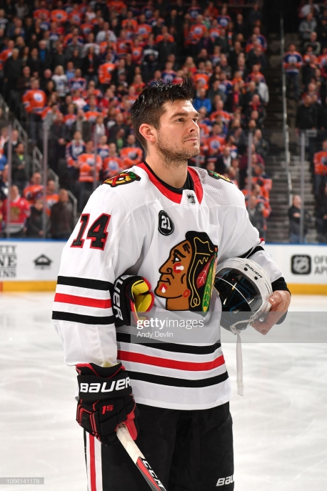 EDMONTON, AB - NOVEMBER 1: Chris Kunitz #14 of the Chicago Blackhawks stands for the singing of the national anthem prior to the game against the Edmonton Oilers on November 1, 2018 at Rogers Place in Edmonton, Alberta, Canada. (Photo by Andy Devlin/NHLI via Getty Images)