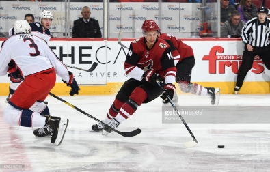 GLENDALE, AZ - FEBRUARY 07: Richard Panik #14 of the Arizona Coyotes skates with the puck behind Seth Jones #3 of the Columbus Blue Jackets during the first period at Gila River Arena on February 7, 2019 in Glendale, Arizona. (Photo by Norm Hall/NHLI via Getty Images)
