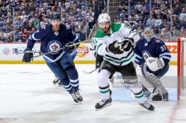 WINNIPEG, MB - JANUARY 6: Adam Lowry #17 of the Winnipeg Jets and Tyler Seguin #91 of the Dallas Stars keep an eye on the play during first period action at the Bell MTS Place on January 6, 2019 in Winnipeg, Manitoba, Canada. (Photo by Jonathan Kozub/NHLI via Getty Images)