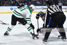 ST. LOUIS, MO - JANUARY 8: Tyler Seguin #91 of the Dallas Stars faces off against Ryan O'Reilly #90 of the St. Louis Blues at Enterprise Center on January 8, 2019 in St. Louis, Missouri. (Photo by Joe Puetz/NHLI via Getty Images)