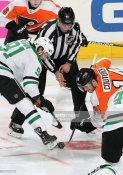 PHILADELPHIA, PA - JANUARY 10: Sean Couturier #14 of the Philadelphia Flyers battles for the puck on a face-off against Tyler Seguin #91 of the Dallas Stars on January 10, 2019 at the Wells Fargo Center in Philadelphia, Pennsylvania. (Photo by Len Redkoles/NHLI via Getty Images)