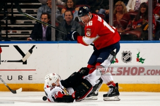 SUNRISE, FL - DECEMBER 16: Aleksander Barkov #16 of the Florida Panthers collides with J.C. Beaudin #64 of the Ottawa Senators at the BB&T Center on December 16, 2019 in Sunrise, Florida. (Photo by Eliot J. Schechter/NHLI via Getty Images)