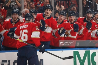 SUNRISE, FL - DECEMBER 29: Teammates congratulate Aleksander Barkov #16 of the Florida Panthers after he scored a first period goal against the Montreal Canadiens at the BB&T Center on December 29, 2019 in Sunrise, Florida. (Photo by Joel Auerbach/Getty Images)