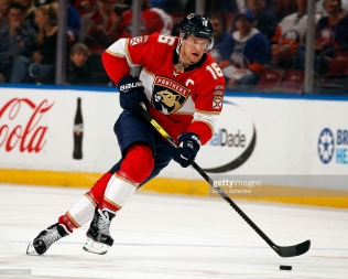 SUNRISE, FL - DECEMBER 12: Aleksander Barkov #16 of the Florida Panthers skates with the puck against the New York Islanders at the BB&T Center on December 12, 2019 in Sunrise, Florida. (Photo by Eliot J. Schechter/NHLI via Getty Images)