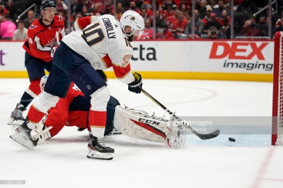 WASHINGTON, DC - NOVEMBER 27: Brett Connolly #10 of the Florida Panthers scores a goal against Braden Holtby #70 of the Washington Capitals in the second period at Capital One Arena on November 27, 2019 in Washington, DC. (Photo by Patrick McDermott/NHLI via Getty Images)