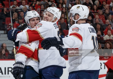 OTTAWA, ON - JANUARY 2: Noel Acciari #55 of the Florida Panthers celebrates his second period goal against the Ottawa Senators with teammates Riley Stillman #61 and Brett Connolly #10 at Canadian Tire Centre on January 2, 2020 in Ottawa, Ontario, Canada. (Photo by Andre Ringuette/NHLI via Getty Images)