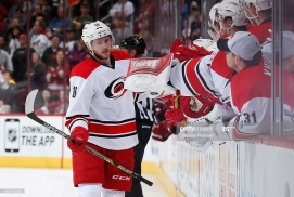 GLENDALE, AZ - FEBRUARY 05: Elias Lindholm #16 of the Carolina Hurricanes high-fives teammates on the bench after scoring a shootout goal against the Arizona Coyotes during the NHL game at Gila River Arena on February 5, 2015 in Glendale, Arizona. The Hurricanes defeated the Coyotes 2-1 in overtime shootout. (Photo by Christian Petersen/Getty Images)