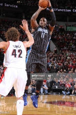 PORTLAND, OR - JANUARY 8: Glen Davis #11 of the Orlando Magic shoots against the Portland Trail Blazers on January 8, 2014 at the Moda Center Arena in Portland, Oregon. NOTE TO USER: User expressly acknowledges and agrees that, by downloading and or using this photograph, user is consenting to the terms and conditions of the Getty Images License Agreement. Mandatory Copyright Notice: Copyright 2014 NBAE (Photo by Sam Forencich/NBAE via Getty Images)