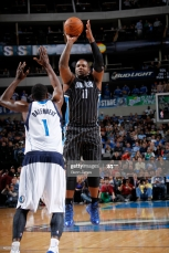 DALLAS, TX - JANUARY 13: Glen Davis #11 of the Orlando Magic shoots a jumper against Samuel Dalembert #1 of the Dallas Mavericks on January 13, 2014 at the American Airlines Center in Dallas, Texas. NOTE TO USER: User expressly acknowledges and agrees that, by downloading and or using this photograph, User is consenting to the terms and conditions of the Getty Images License Agreement. Mandatory Copyright Notice: Copyright 2014 NBAE (Photo by Glenn James/NBAE via Getty Images)