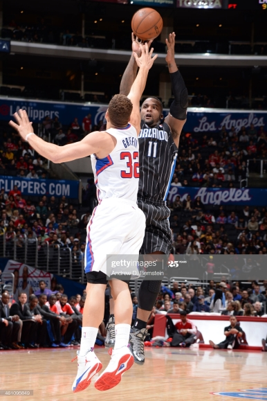 LOS ANGELES, CA - JANUARY 6: Glen Davis #11 of the Orlando Magic shoots against Blake Griffin #32 of the Los Angeles Clippers at STAPLES Center on January 6, 2014 in Los Angeles, California. NOTE TO USER: User expressly acknowledges and agrees that, by downloading and/or using this Photograph, user is consenting to the terms and conditions of the Getty Images License Agreement. Mandatory Copyright Notice: Copyright 2014 NBAE (Photo by Andrew D. Bernstein/NBAE via Getty Images)