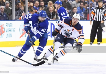 TORONTO, ON - DECEMBER 10: Toronto Maple Leafs center Nazem Kadri (43) battles with Edmonton Oilers center Connor McDavid (97) during the third period in a game between the Edmonton Oilers and the Toronto Maple Leafs at Air Canada in Toronto Ontario Canada. The Toronto Maple Leafs won 1-0. (Photo by Nick Turchiaro/Icon Sportswire via Getty Images)