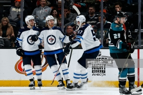 ANAHEIM, CA - MARCH 20: Kyle Connor #81, Nikolaj Ehlers #27, and Tyler Myers #57 of the Winnipeg Jets celebrate Connor's third period goal against Devin Shore #29 and the Anaheim Ducks during the game on March 20, 2019 at Honda Center in Anaheim, California. (Photo by Debora Robinson/NHLI via Getty Images)