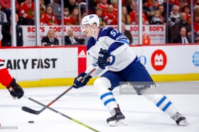 CHICAGO, IL - APRIL 1: Tyler Myers #57 of the Winnipeg Jets plays the puck down the ice during first period action against the Chicago Blackhawks at the United Center on April 1, 2019 in Chicago, Illinois. (Photo by Darcy Finley/NHLI via Getty Images)