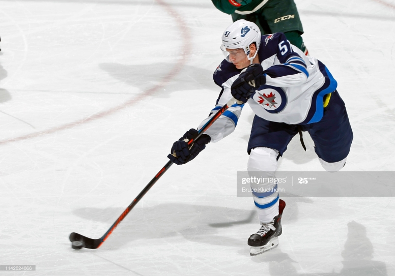 ST. PAUL, MN - APRIL 02: Tyler Myers #57 of the Winnipeg Jets takes a shot on goal during a game with the Minnesota Wild at Xcel Energy Center on April 2, 2019 in St. Paul, Minnesota. (Photo by Bruce Kluckhohn/NHLI via Getty Images)